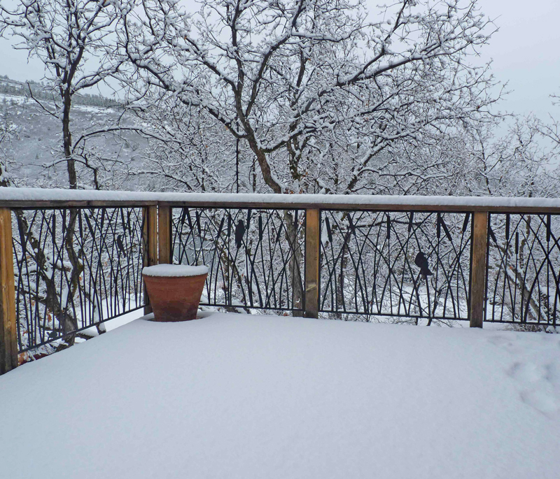 Cattails deck railing in snow by Trellis Art Designs